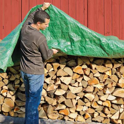 Fire wood under storage tarp