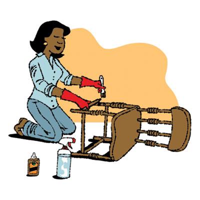 woman using glue to fix loose chair leg