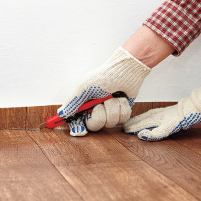 hands installing vinyl flooring