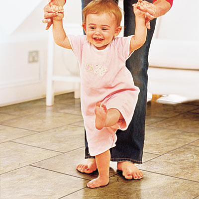 baby walking on vinyl flooring