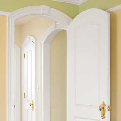 The Nursery's arched entryways with crown molding design