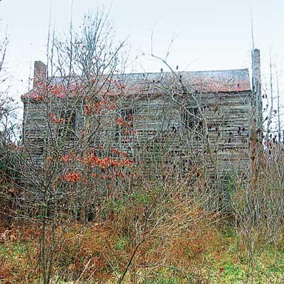 Dilapidated timber-frame farmhouse