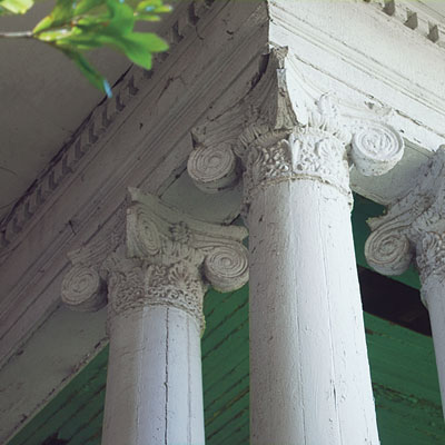 Exterior porch columns of this Mississippi Queen Anne