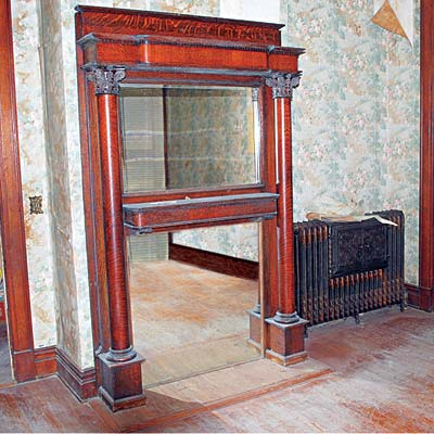 Oak mantel in this Mississippi Queen Anne