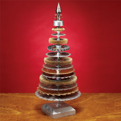 wire brushes and saw blades stacked together in the shape of a christmas tree