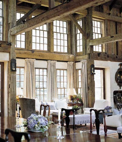 dining room in converted barn with exposed roof beams