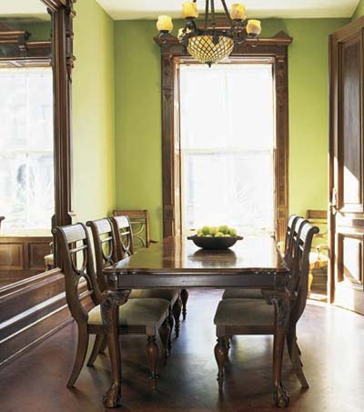 dining room in rescued Italianate townhouse with window trim and parquet floor
