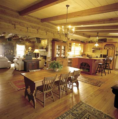 open-plan kitchen dining room in log cabin