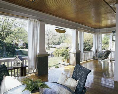 Porch with beadboard ceiling, thick columns and pine floors in an Atlanta Bungalow