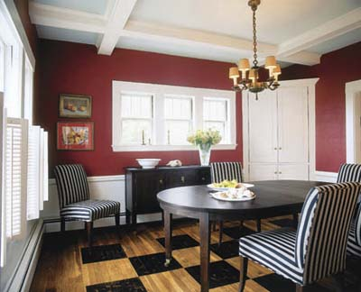 dining room with coffered ceiling and checkered wood floors