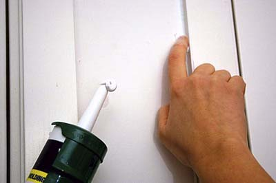 hand soap to smooth out caulk lines