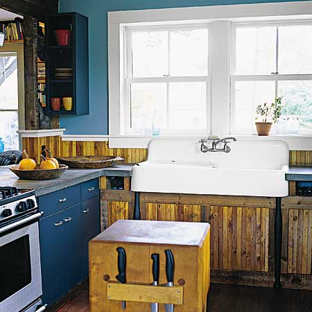kitchen with cast iron sink and salvaged woods