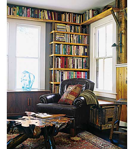 library with built in shelving and salvaged table