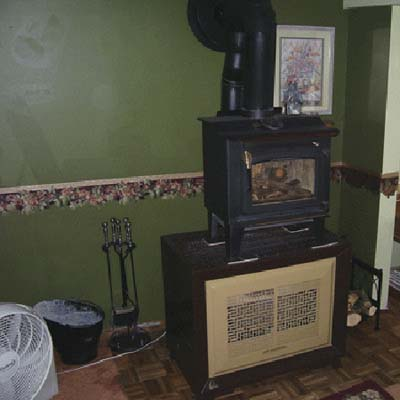 wood stove stacked on gas heater
