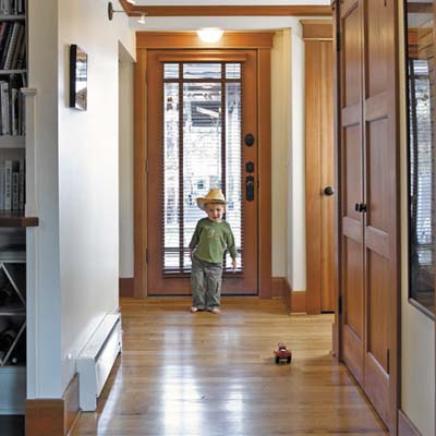 homeowners' son Devon plays on entry area floor made from recycled maple from an old linen mill