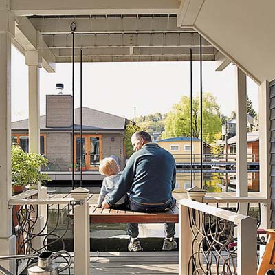 remodeled houseboat owner and his son sitting on their deck on Seattle's Lake Union