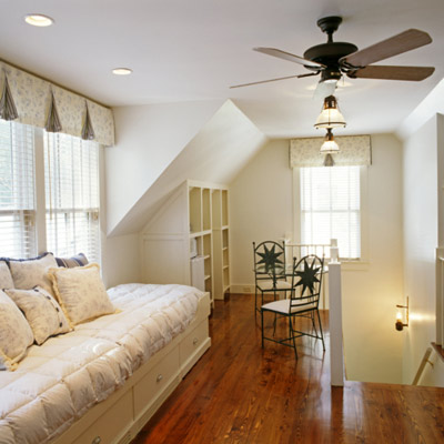 room with day bed window seat and ceiling fan