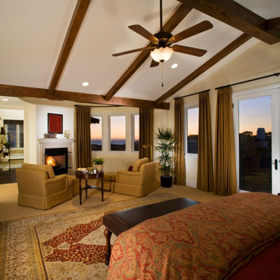 living room with high ceiling and ceiling fan with downrod