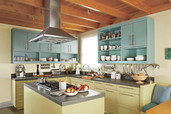 green kitchen with open shelving