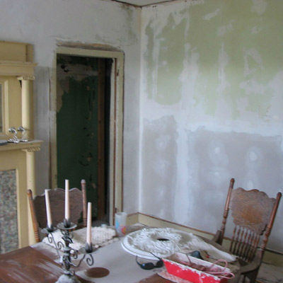 before image of 1879 parlor with paint stenciling to look like period wallpaper