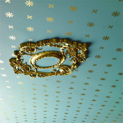 ceiling of 1879 parlor with paint stenciling to look like period wallpaper