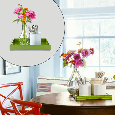 green serving tray, decanter-style vase with flowers and silverware holder