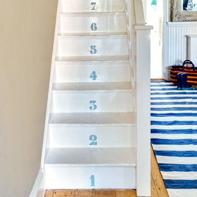 cottage style painted wood steps with numbers on risers