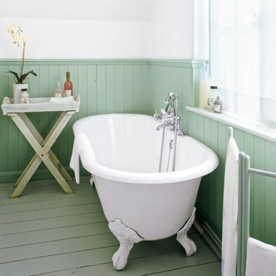 cottage style bathroom with painted wood baseboards and wainscoting