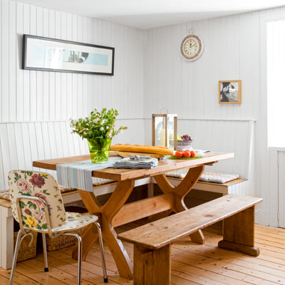 cottage style dining nook with beadboard walls to the ceiling