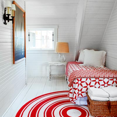 cottage style bedroom with horizontal wood planks on walls