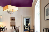 dining room with rich purple painted ceiling