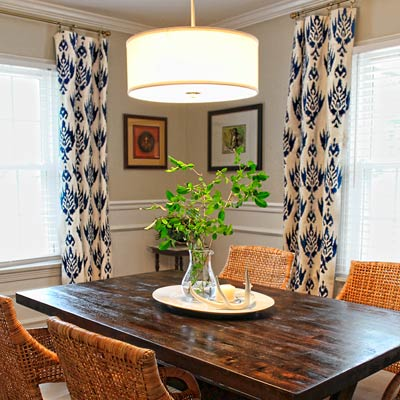 dining room budget redo after DIY curtains wicker chair pendant mahogany stain table