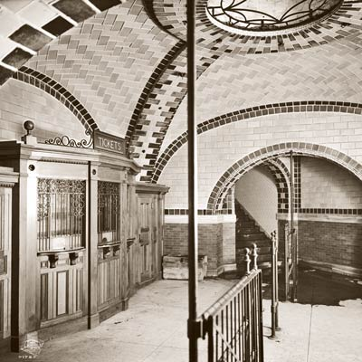 ticket office in former city hall subway stop in new york city with ceramic subway tiles