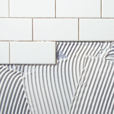 white ceramic subway tile with grout