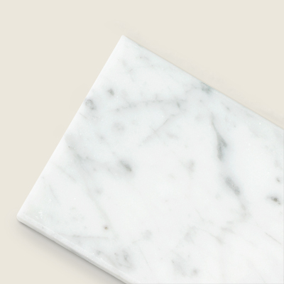 subway tile in Carrara marble