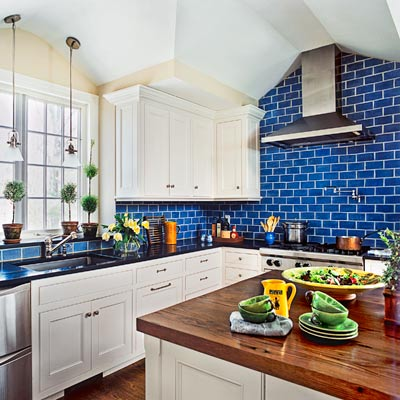 kitchen with blue subway tile backsplash