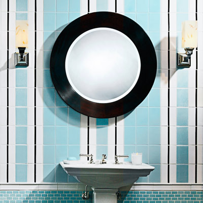 powder room with light blue, white and black vertical subway tile pattern