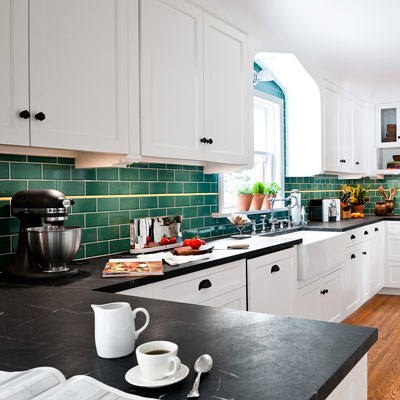 kitchen with white cabinets and green ceramic subway tile with running bond staggered pattern