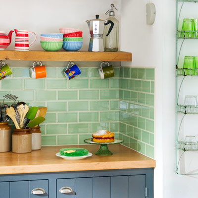 kitchen with wood counters and shelves, backsplash of light green subway tile with off-white grout