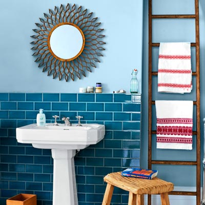 colorful bath with deep blue ceramic subway tile and light blue grout