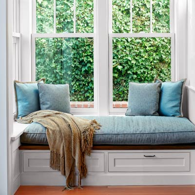 window seat with storage drawers below and a ledge 