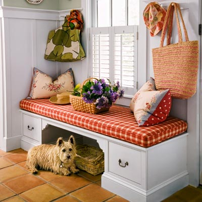 window seat in entryway with cubby and drawers for storage