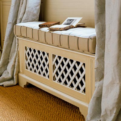 window seat over radiator with lattice panels to let heat escape