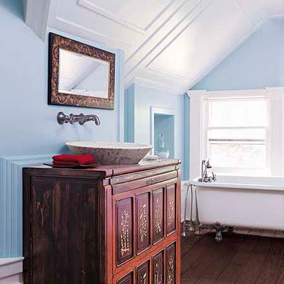 bathroom with antique sink cabinet and soaking tub