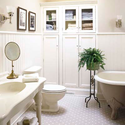 Storage cupboard in vintage-style bathroom