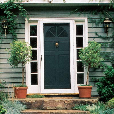 white aluminum screen door on house front door