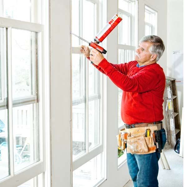 Tom Silva sealing air gaps in windows with canned spray foam