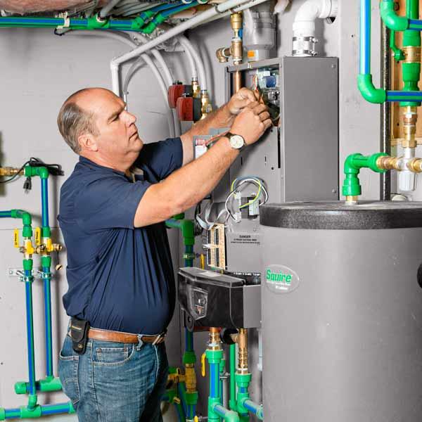 Richard Trethewey setting up HVAC system for slashing energy costs