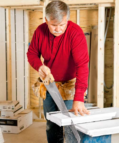 Tom Silva cutting framing and insulation panels for basement for slashing energy costs