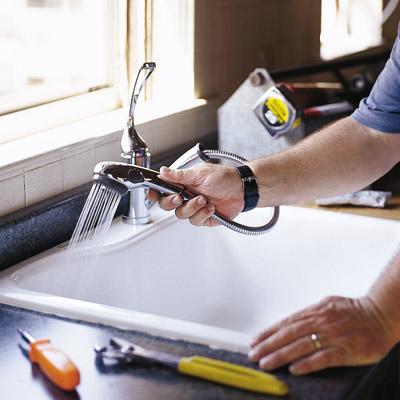 man installing a sink